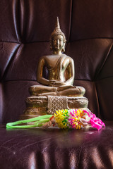 Still Life Buddha Statue With Garland