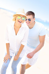 Couple chasing at the beach