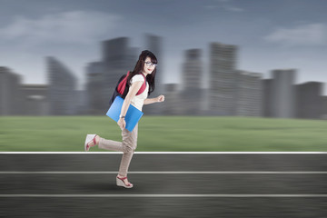 Student running on tracks 1