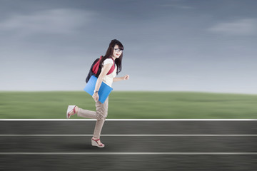 Student running on tracks