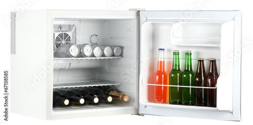 Mini fridge full of bottles of alcoholic beverages isolated Poster