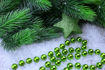 Christmas decorations and fir tree on light background