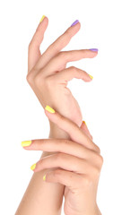 Female hand with stylish colorful nails, isolated on white