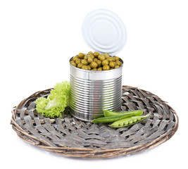 Fresh  and canned peas in tin on wicker mat, isolated on white