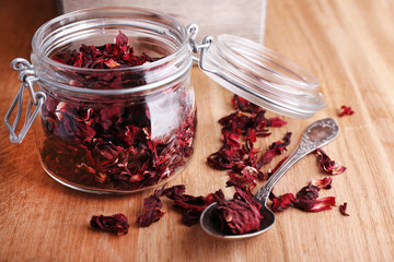 Dried hibiscus tea in glass jar, brown sugar  in box