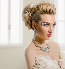 Bride with creative make-up and hairstyle