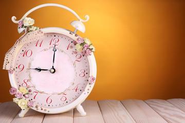 Beautiful vintage alarm clock with flowers