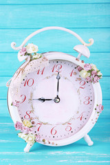 Beautiful vintage alarm clock with flowers