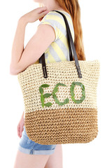 Woman with summer wicker Eco bag, isolated on white