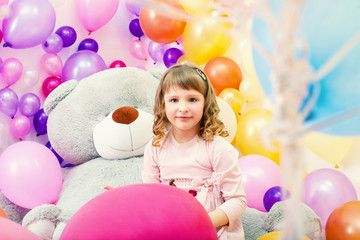 Smiling little girl posing in playroom