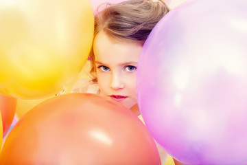Cute girl posing with balloons, close-up