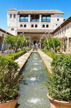 Fountain and gardens in Alhambra palace, Granada, Spain.