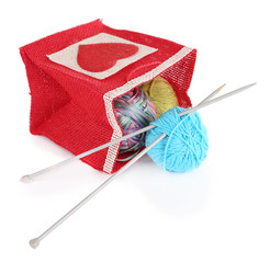 Woolen balls of yarn and wooden knitting needles in rustic