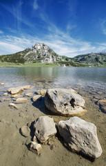 Rocks on lake in Picos de europa, Asturias, Spain.