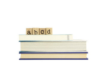abcd word on wood stamps and books