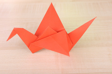 Origami crane on wooden table