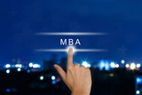 hand pushing The Master of Business Administration (MBA or M.B.A poster