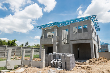 New home under construction using steel frames against cloudy sk