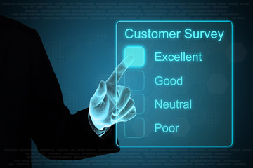 business hand clicking customer survey on touch screen