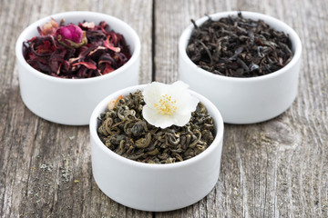 Assorted dry herbal teas in white bowls