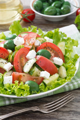 fresh green salad with vegetables and feta, vertical