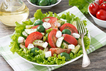 fresh green salad with vegetables and feta