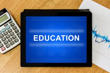 Education word on digital tablet