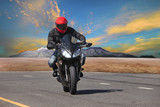 young man riding motorcycle in asphalt road curve use for extrem
