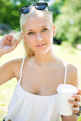 Beautiful teenage girl drinking coffee outdoor