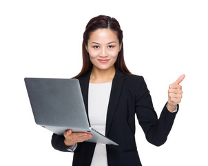 Businesswoman hold laptop computer and thumb up