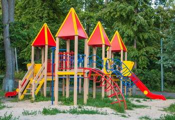 Playground with slides and climbing frame in a city park