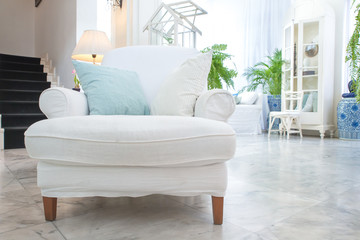 white armchair with pillow in living room ,vintage style