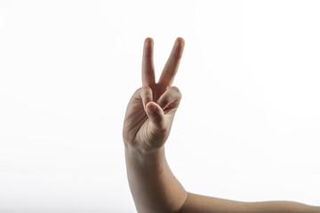 Young hand make 2 fingers gesture