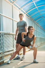 Athletic couple pumping up muscles