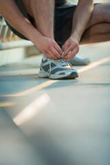 Man lacing shoes