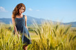 woman on golden cereal field in summer