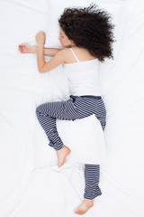 "Young woman sleeping in ""starfish"" position"