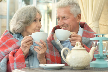old couple drinking tea