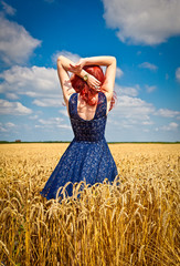 Happy woman in wheat , summer time.