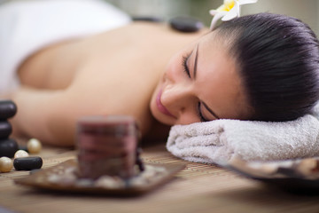 Young woman relaxing at spa salon