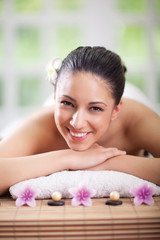 Young smiling woman at spa salon