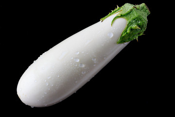 White Eggplant on black background