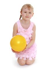little girl hugging the ball.