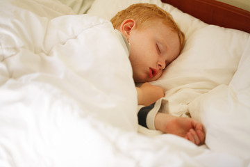 Young Boy Sleeping In Bed