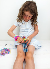 small girl  loom banding