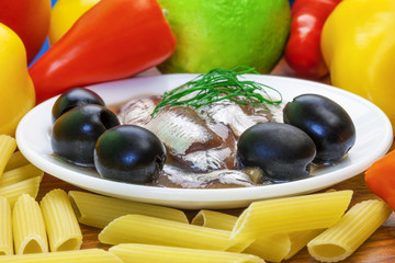 Anchovy fillets with macaroni olives and vegetables