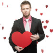 cheerful businessman holding red heart