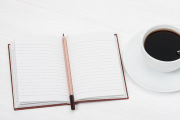 Notebook Mock Up And Cup Of Coffee On White Painted Wooden Desk