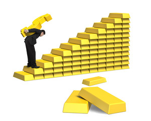 Businessman carrying bullion on gold stairs