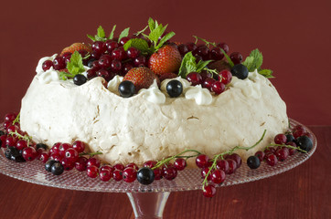 Meringue Cake Pavlova with cream, berries  and mint